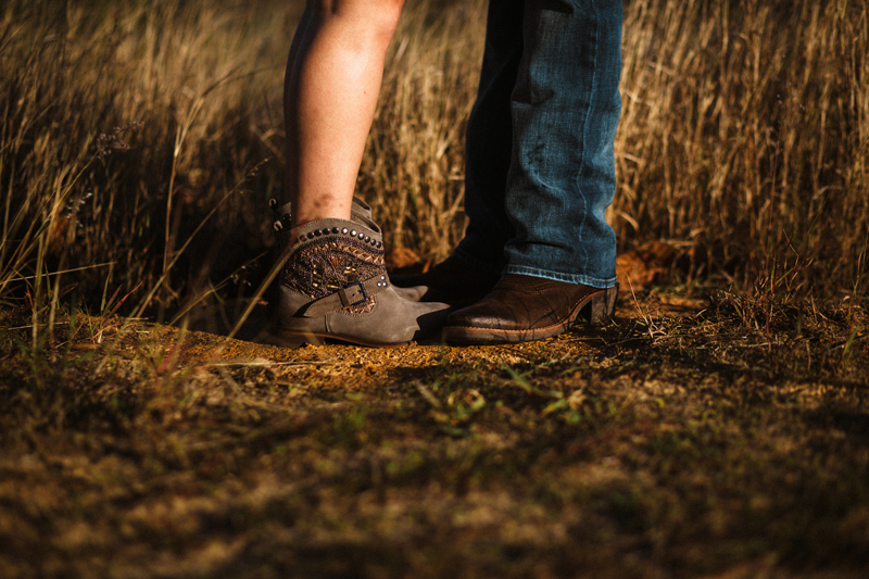 bella collina engagement session: bride and groom boots in field
