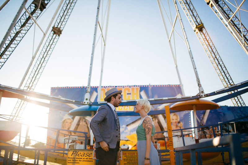 tampa wedding photographer: bride and groom standing in front of ferris wheel