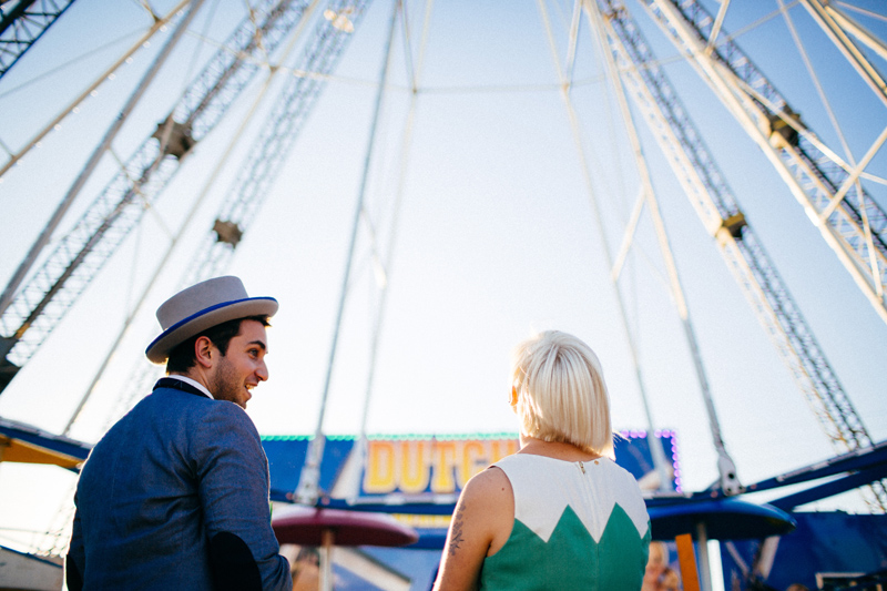 tampa wedding photographer: groom talking to bride in front of ferris wheel