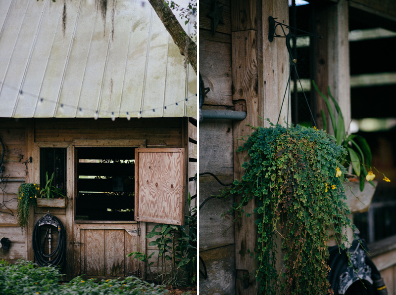 cross creek ranch wedding: shed with hanging greenery