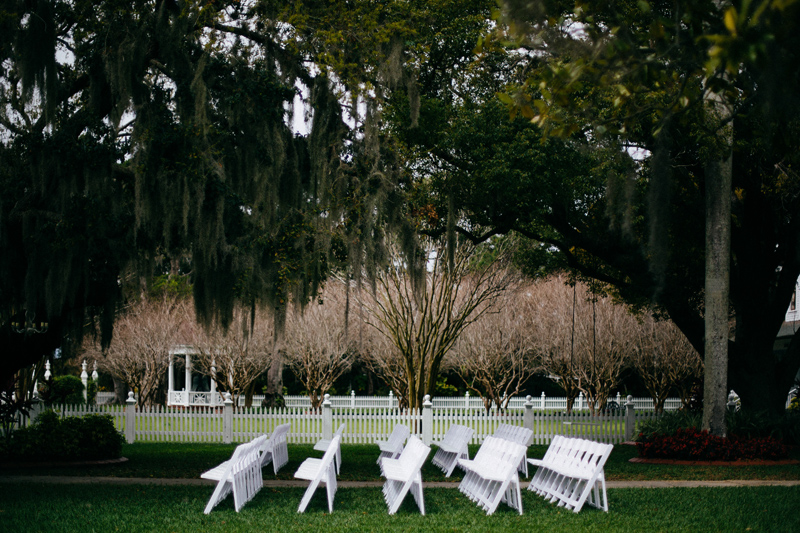PALMETTO RIVERSIDE BED & BREAKFAST WEDDING: white ceremony chairs on front lawn