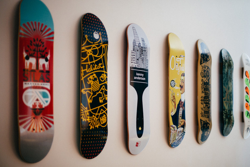 POST CARD INN WEDDING: colorful skateboards hanging on the wall